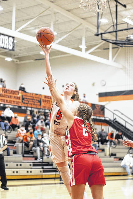 Portsmouth West junior Eden Cline (5) scored 12 of her 15 points during the first half of the Lady Senators' 67-35 season-opening home win over Rock Hill.