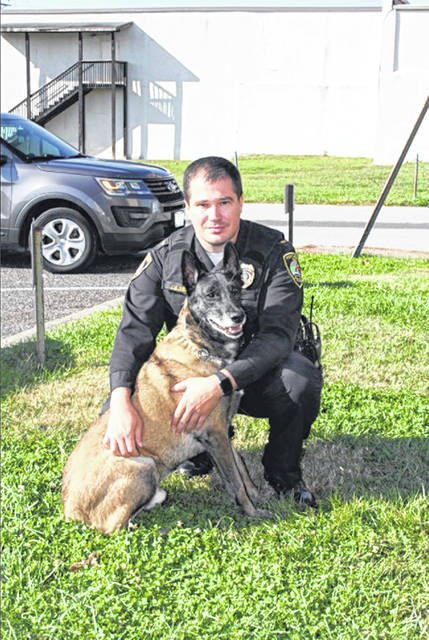 Lt. Josh Justice and Dark, worked together for seven and a half years before the K-9 retired last week. Photo courtesy of Portsmouth Police Department.