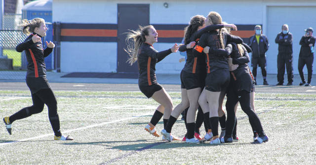 The Wheelersburg Lady Pirates celebrate after the game-winning goal in their 4-3 overtime victory over Eastern Brown on Saturday in the Division III district championship match.