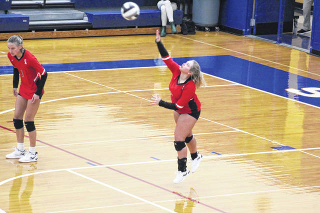 South Webster senior Kendall Bender (8) attempts a serve during the Lady Jeeps' three-set win over Notre Dame in a Division IV district final played at Southeastern High School.