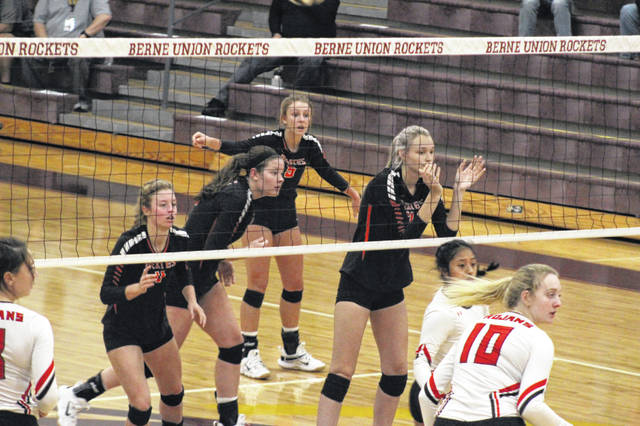 Wheelersburg seniors (L-R) Lauren Jolly, Emily Boggs, Kaylee Darnell and Kylee Barney prepare for a serve during their five-set loss to Tuscarawas Valley in a Division III regional semifinal.