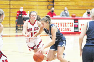 Lady Titans' late run fuels win over Jeeps