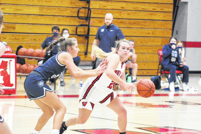 South Webster freshman Skylar Zimmerman (22) scored seven of her nine points during the first half in her Lady Jeeps' debut against Notre Dame on Saturday.