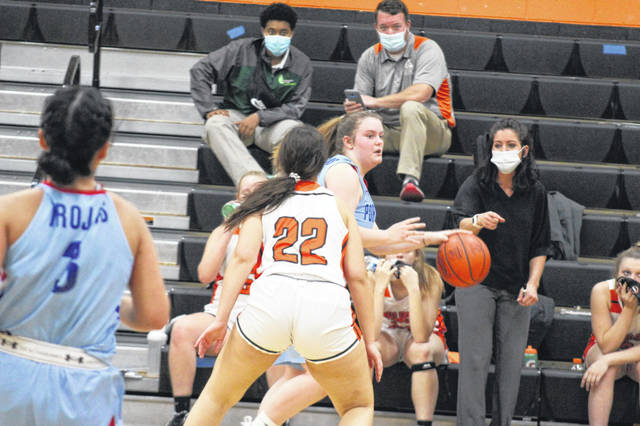 Portsmouth freshman Taylor Thomas (4) was key to the Lady Trojans' 31-23 rebounding advantage in their six-point road win over Whiteoak in non-league play.