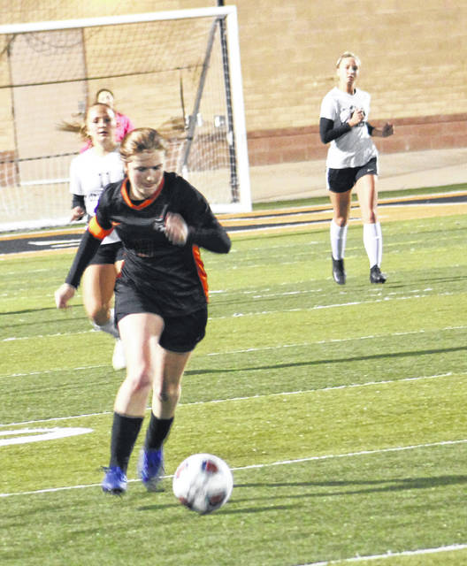 Wheelersburg's Annie Coriell (7) controls possession during the Lady Pirates' Division III girls soccer regional semifinal match against Lynchburg-Clay on Tuesday night.