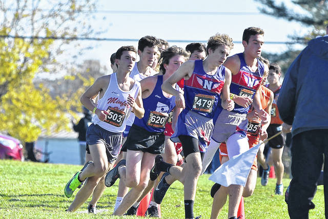 Minford's Dutch Byrd, Portsmouth's Charlie Putnam, and Northwest's Kailan Marshall and Josh Shope (L-R) each finished in the top-22 of the Division II, Region 7 boys cross country race held at Pickerington North High School on Saturday.