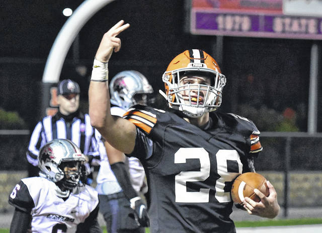 Ironton senior Reid Carrico celebrates after scoring a touchdown in the Fighting Tigers' 21-14 victory over Harvest Prep in the Division V Region 19 semifinals.