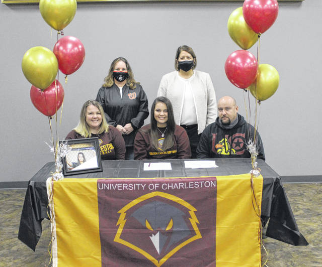 Wheelersburg High School senior Rylie Hughes, seated center, announces her intention to play college softball for the University of Charleston. Seated with Hughes are mother Ashley Paulins (left) and stepfather Jason Potter (right); standing are Wheelersburg High School assistant softball coach Susan Reutzel (left) and Wheelersburg High School head softball coach Teresa Ruby (right).
