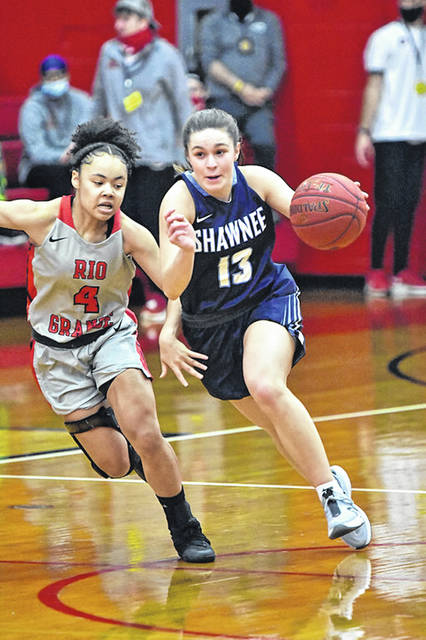 Shawnee State's Abbie Kallner (13), a former Wheelersburg High School standout, drives past Rio Grande defender Chyna Chambers (4) during Thursday's women's college basketball game at the University of Rio Grande's Newt Oliver Arena.