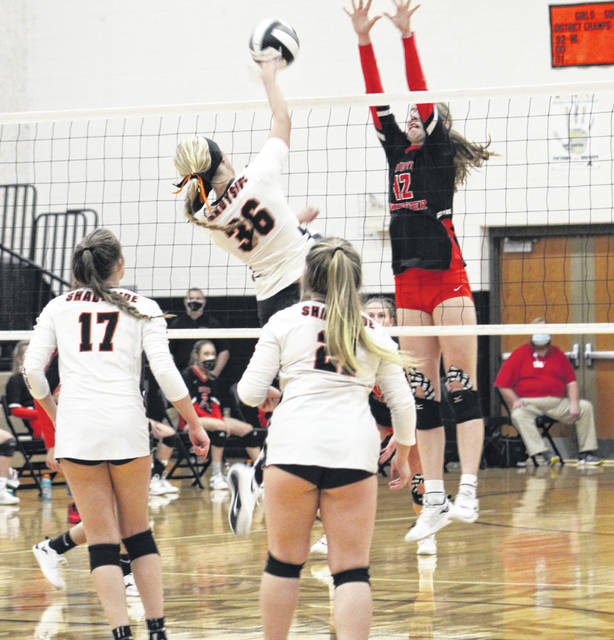 South Webster's Faith Maloney goes up for a block over Shadyside's Kylie Jo Baker (36) during Thursday night's Division IV regional semifinal volleyball match at New Lexington High School.