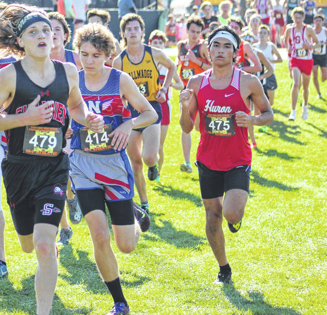 Northwest junior Kailan Marshall (center) competes in Saturday's Division II boys state cross country race and finished four spots away from earning all-Ohio honors.