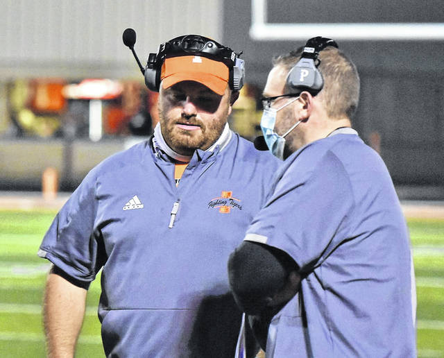 Ironton head football coach and former Portsmouth West standout Trevon Pendleton (left) completes his third season with the Fighting Tigers as part of Saturday's Division V state championship game against Kirtland.