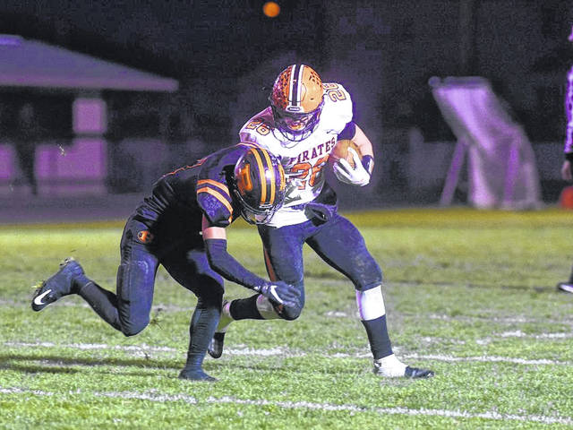 Wheelersburg's Carson Williams (26) carries the ball during the Pirates' Division V Region 19 semifinal football playoff game against host Ridgewood on Saturday night.