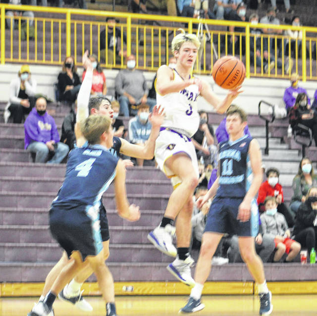 Valley sophomore Ty Perkins, who scored a team-high 16 points, splits three Adena defenders during Tuesday night's non-league boys basketball game at Valley High School.