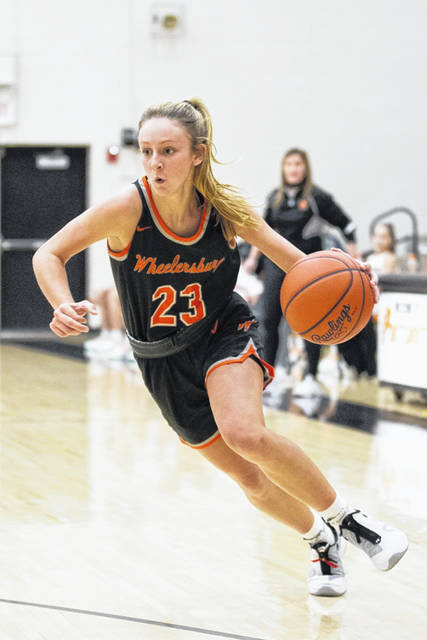 Wheelersburg senior Kaylee Darnell (23) scored a dozen points and made two key fourth-quarter layups off steals during the Lady Pirates' 50-46 win at West on Thursday night.
