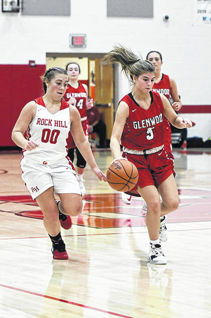 New Boston's Cadence Williams (5) scored a game-high 24 points in the Lady Tigers' 67-21 win over East in a Southern Ohio Conference Division I contest.