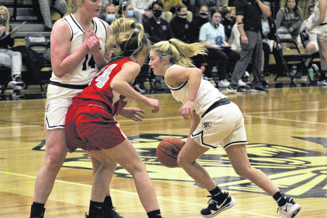 Notre Dame senior Claire Dettwiller (14) sets a screen for senior Ava Hassel (3) during the Lady Titans' 68-31 home-opening win over Symmes Valley in Southern Ohio Conference Division I play.