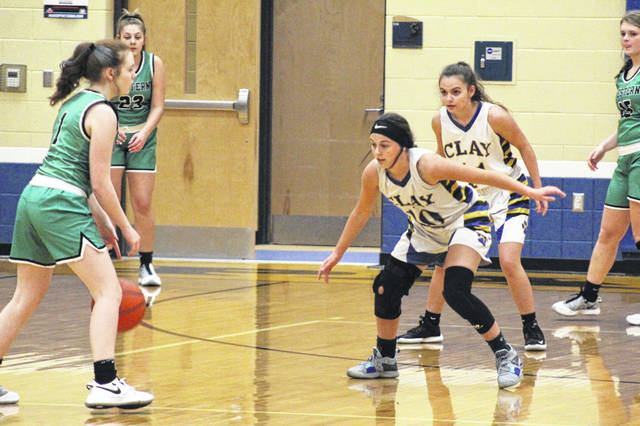 Clay seniors McKenzie Loper (10) and Sophia Gatti (11) defend during the first half of the Lady Panthers' 54-39 home loss to Western in SOC I play.