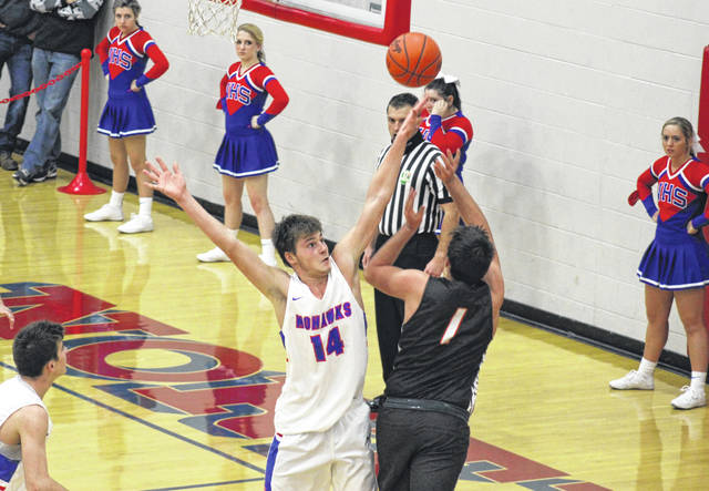 Northwest senior Brycen Carver (14) contests an Eastern shot attempt during the Mohawks' 50-47 double-overtime home win over Eastern in Southern Ohio Conference Division II play.