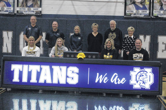 Notre Dame senior Ava Hassel signed her national letter-of-intent on Friday at Notre Dame High School, continuing her academic and basketball career at DePauw University. Pictured — Front row (L-R): Sophia Hassel, Ava Hassel, Amy Hassel, David Hassel; back row (L-R): Joe Smith, J.D. McKenzie, Crystal McKenzie, Beth Haney, Henry Oberling, Ann Oberling.