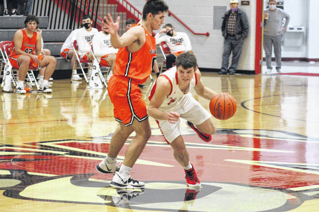 Minford senior Matthew Risner (10) looks to drive during the Falcons' 28-point home win over West on Friday night in Southern Ohio Conference Division II play.