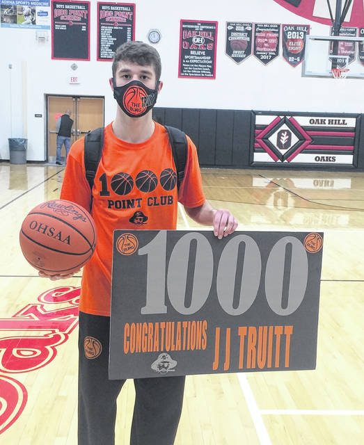 Wheelersburg senior J.J. Truitt, with a game-high 17 points, tallied his 1,000th career point on Friday night in the Pirates' 70-42 victory at Oak Hill.