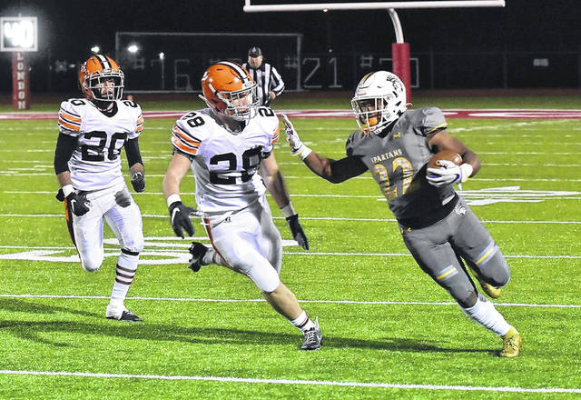 Roger Bacon running back Corey Kiner is the 34th winner of the prestigious Ohio Mr. Football award. Kiner ran for 1,866 yards, averaged 13.8 yards per carry, had 37 touchdowns and amassed 2,133 all-purpose yards as Roger Bacon went 10-1 in 2020. Kiner is shown here against Ironton and Reid Carrico (28), who was another finalist for the Mr. Football award.