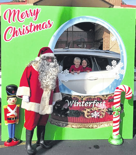 Minford High School Marching Band Boosters set-up for photos with Santa in a drive-through safe way.
