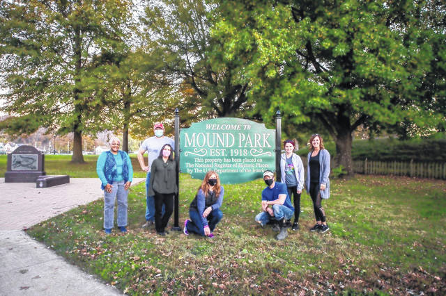 (Far left) Lyvette Mosley, newly appointed Portsmouth City Councilwoman in the 4th Ward, which is where Mound Park is located. Mosley is a member of the Connex group and is standing in front of one of the new signs with some of the other board members of Connex.