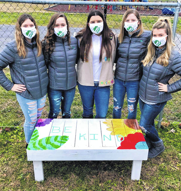 Hunter Slack (center) stands behind the other bench she made (Be Kind), with her girls scout friends (L to R) Savannah Williams, Mia Crum, Slack, Maelynn Howell, and Abby Webb.