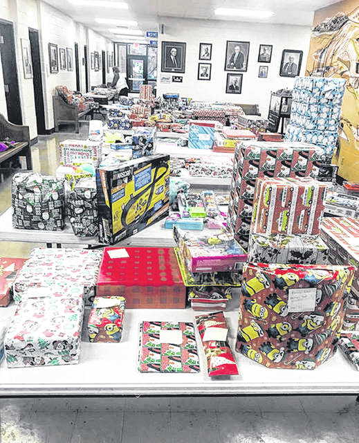 Village of New Boston Toy Drive is a big project and getting the presents wrapped this year is a little more difficult with less people available to help wrap the toys.