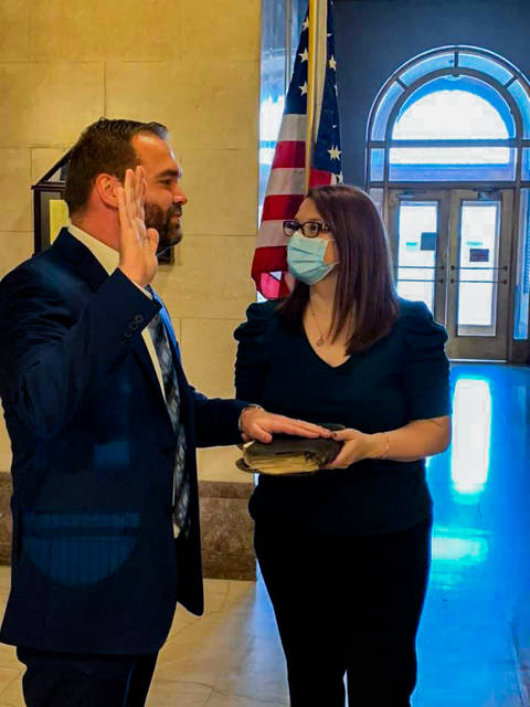 Scottie Powell being sworn in Saturday as a new Scioto County Commissioner. Powell will join Bryan Davis and Cathy Coleman as Scioto County Commissioners, filling the seat that was open due to the unexpected passing of Mike Crabtree.