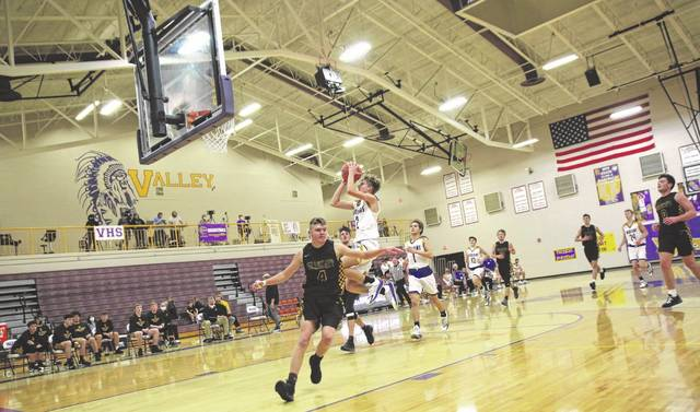 Valley freshman Jace Copley (2) attempts a shot near the rim during the Indians' 74-45 win over Paint Valley on Tuesday night in non-league play.