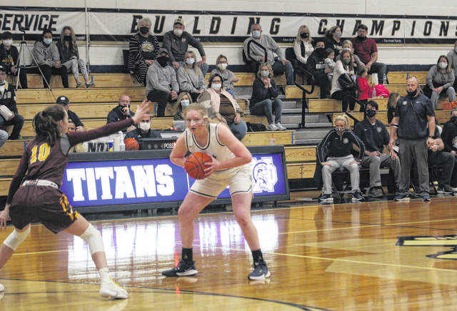 Notre Dame senior Claire Detwiller is guarded by Berne Union's Sophia Kline during Saturday night's non-league girls basketball game at Notre Dame High School.