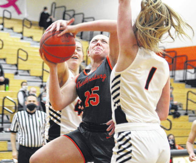 Wheelersburg's Makenna Walker (25) goes strong for a putback attempt as Waverly's Kelli Stewart (1) defends during Saturday's Southern Ohio Conference Division II girls basketball game at Waverly High School.