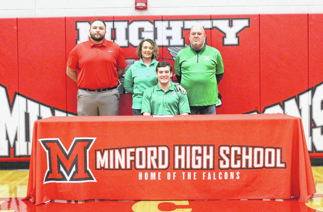 Minford High School senior Elijah Vogelsong-Lewis, seated, recently signed his national letter-of-intent to play college baseball at Marshall University. Pictured with Vogelsong-Lewis are, from left, Minford High School baseball assistant coach Austin Howard, mother Traci Vogelsong-Lewis and father Glenn Vogelsong-Lewis.