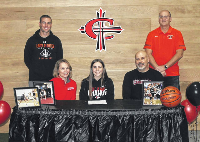 Wheelersburg High School senior Ellie Kallner, seated center, announces her intention to play college basketball at Concordia University. Seated with Kallner are mother Jodi Kallner (left) and father Aaron Kallner (right). Standing are Wheelersburg High School girls basketball assistant coach Tom Kaskey (left) and Wheelersburg High School girls basketball head coach Dusty Spradlin (right).