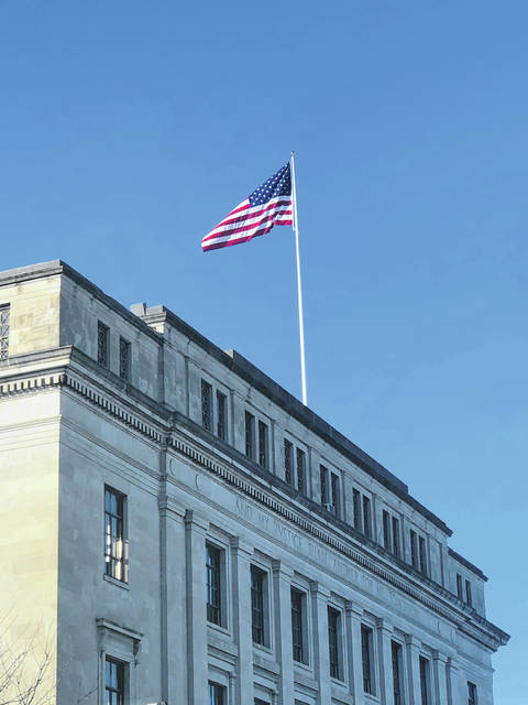 The Scioto County Commissioners unveiled the new flag poles on the courthouse roof earlier this week. Photo courtesy of Bryan Davis.