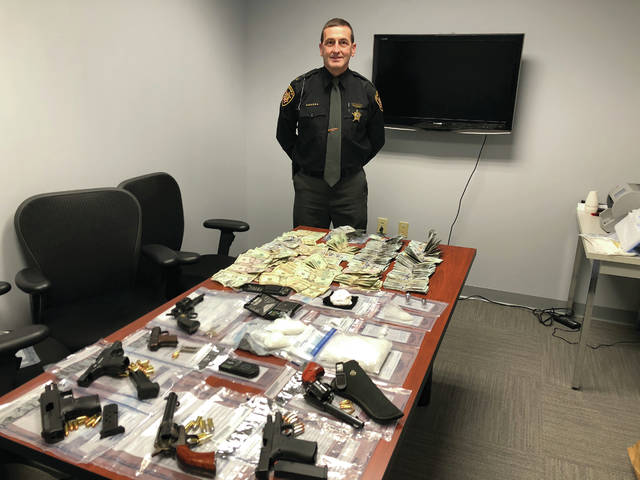 "Scioto County Sheriff David Thoroughman makes first bust after being sworn in. Officers discovered and seized approximately 635 grams of suspected methamphetamine, a.k.a ""ice"", 90 grams of powder suspected of being fentanyl, 7 firearms, $28,308 cash, and additional evidence of drug trafficking. Estimated street value of the suspected drugs seized is $36,200."