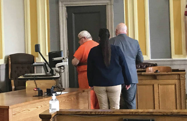 Michael Mearan (left) walking out of the Scioto County Common Pleas Court after pleading not guilty and having his bond set at $300,000 on Monday, Oct. 26.