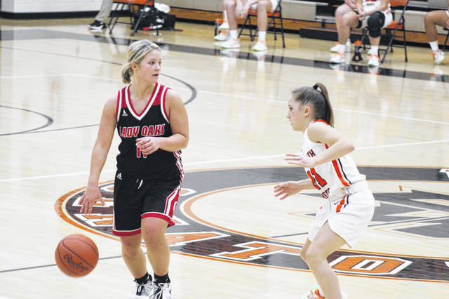 Portsmouth West freshman Emma Sayre (21) defends Oak Hill junior Brooke Howard (11) during the Lady Senators' 56-48 home loss to the Lady Oaks in Southern Ohio Conference Division II play.