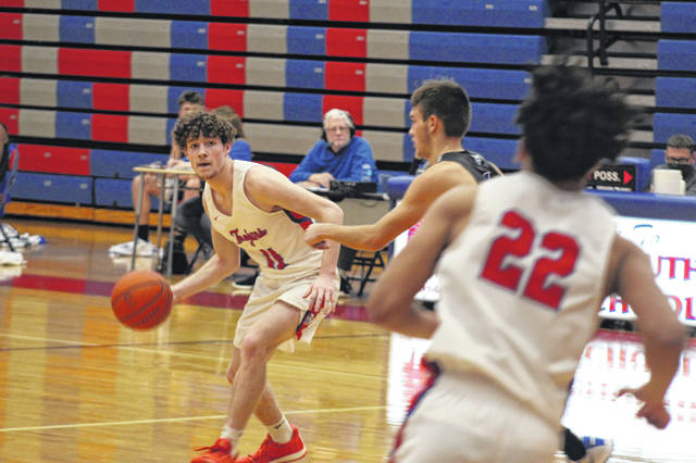 Portsmouth senior Chris Duff (11) scored a game-high 26 points in the Trojans' 58-55 home win over Gallia Academy in Ohio Valley Conference play on Tuesday night.