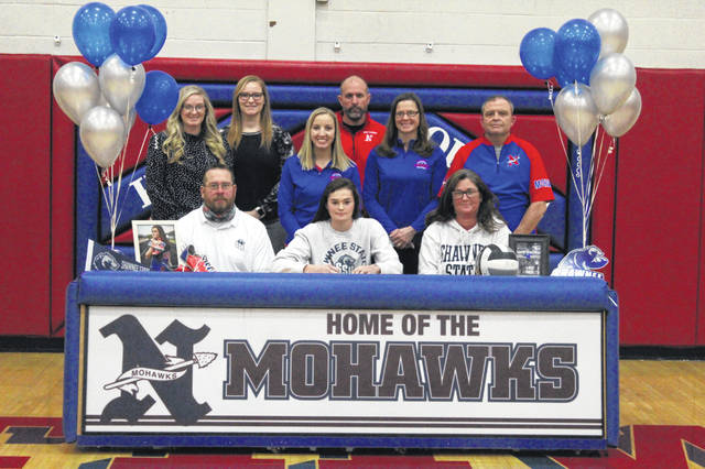 Northwest High School senior Haidyn Wamsley, seated center, signed her letter of intent to continue her education and join the volleyball and track and field teams at Shawnee State University.