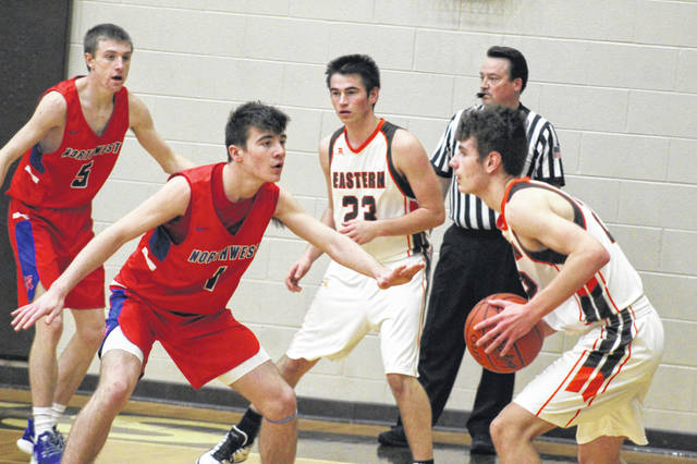 Northwest's Connor Lintz (1) and Landen Smith (5) defend in the half court during the Mohawks' 44-39 road win over Eastern in boys Southern Ohio Conference Division II play.
