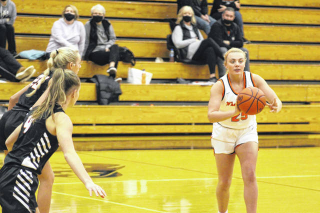 Wheelersburg sophomore Makenna Walker (25) looks to pass the ball during the Lady Pirates' 68-30 win over Waverly on Thursday in Southern Ohio Conference Division II play.