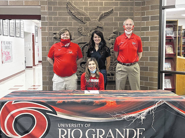 Minford senior Kara Dillon recently signed her letter of intent to continue her academic studies and run cross country and track at the University of Rio Grande. Pictured: Seated - Kara Dillon. Standing (L-R) - Coach Jordan Cunningham, Coach Ann Marie Allen, Coach Bob Willey.