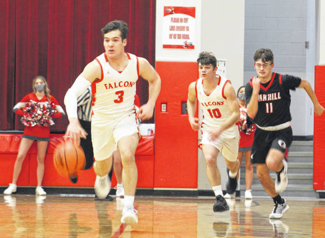 Minford's Elijah Vogelsong-Lewis (3) leads a fast break as teammate Matthew Risner (10) and Oak Hill's Landon Hines (11) trail the play during Friday night's Southern Ohio Conference Division II boys basketball game at Minford High School.