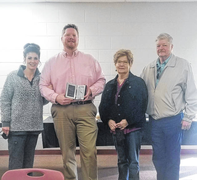 (Left to right): Stockham's wife Angela, Stockham, Stockham's mother, Sharon and father, Joe who were among the small group gathered to celebrate his receiving of the hero award.