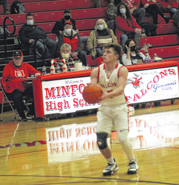 Minford senior Skyler Knore (5) nailed this three-point attempt to get the host Falcons to within 60-57 during their Southern Ohio Conference Division II boys basketball game against Waverly on Tuesday night at Minford High School.