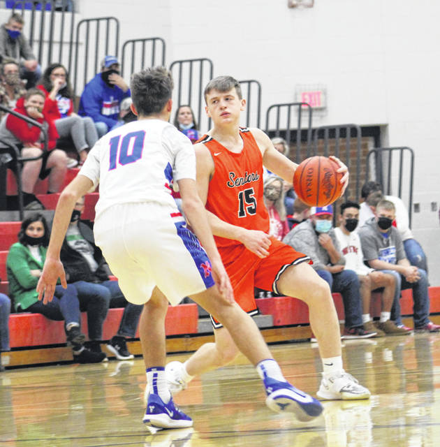 West's Noah Coleman (15) looks to drive against Northwest's Jay Jenkins (10)during Wednesday night's Southern Ohio Conference Division II boys basketball game at Northwest High School.
